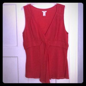 Sleeveless red blouse